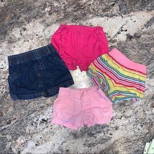 4 pairs of baby girl shorts 2 Nb and 2 pair 0-3m